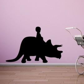 Sticker enfant sur un rhinocéros