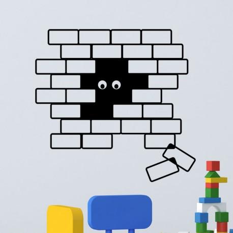 Sticker des yeux dans le trou du mur